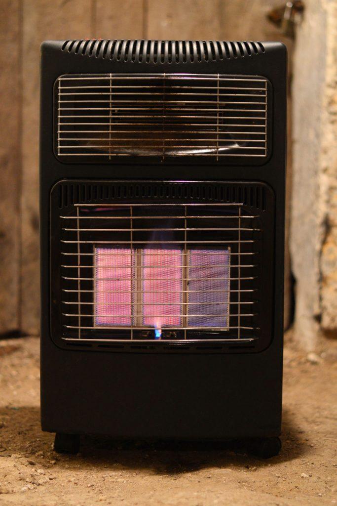 An oil furnace heater inside a small room