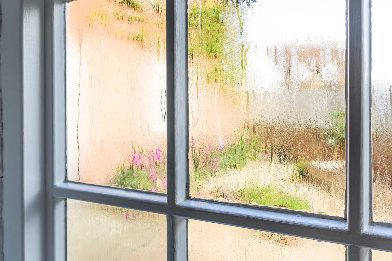 Condensation on an old window pane of a home