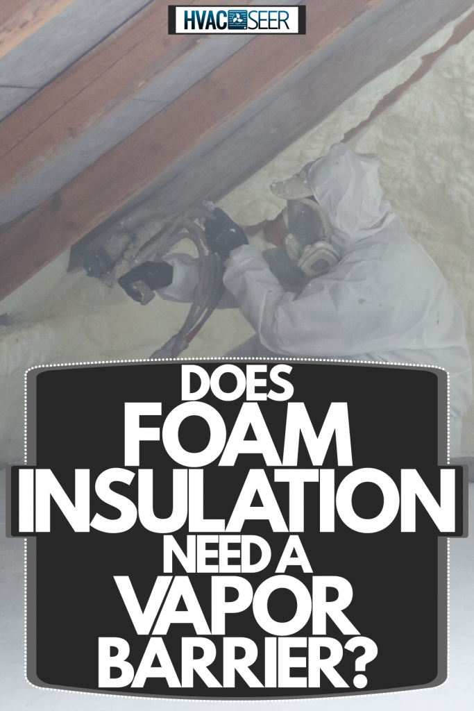A home insulation specialist spraying insulation foam on the roof of the attic, Does Foam Insulation Need A Vapor Barrier?