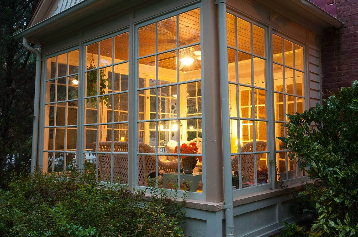 Evening photograph of a home sunroom