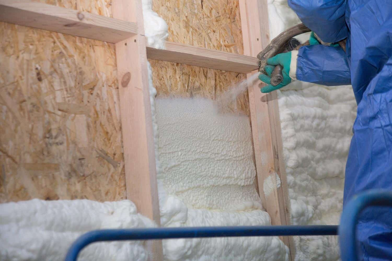 Foam applied to the walls to warm the house at construction