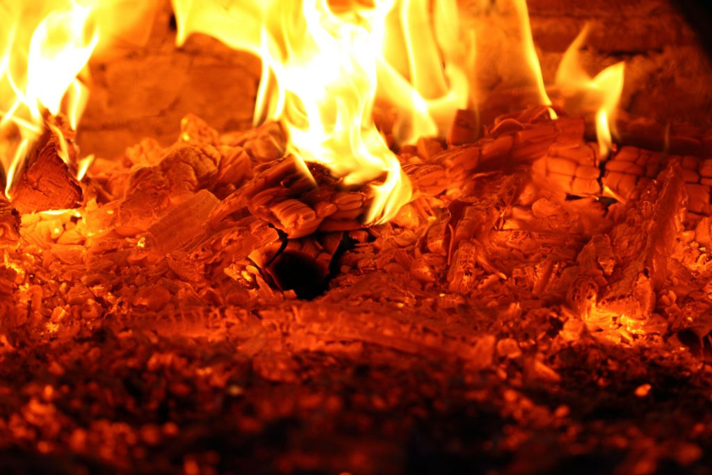 Glowing embers of wood in a wood stove