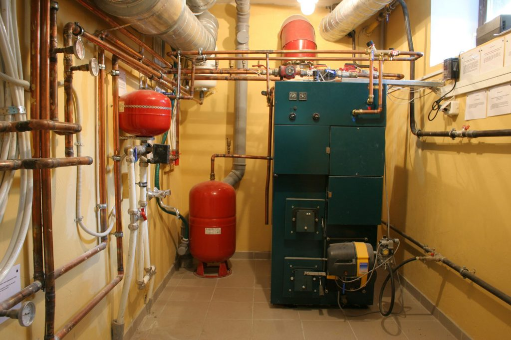 Inner workings of an oil furnace system rool