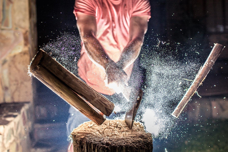 A man chops a piece of firewood
