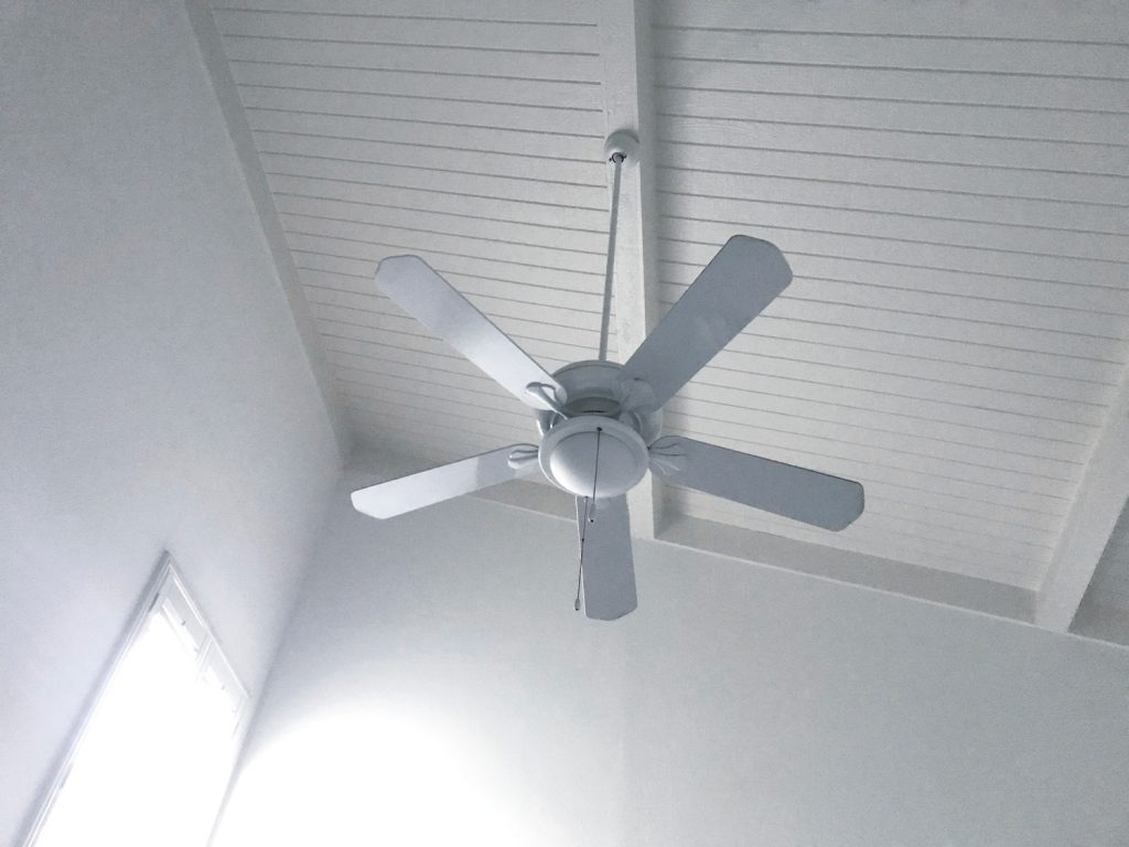Beach House Ceiling fan mounted on a sloped ceiling