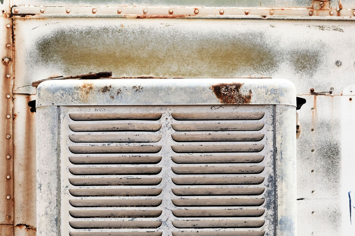Close up shot of a grungy old thrashed swamp cooler as found in a junkyard in the middle of the desert, How To Remove Rust From An Evaporative Cooler
