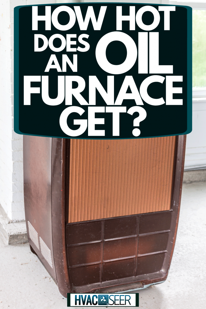 A brown colored oil furnace inside a living room, How Hot Does An Oil Furnace Get?