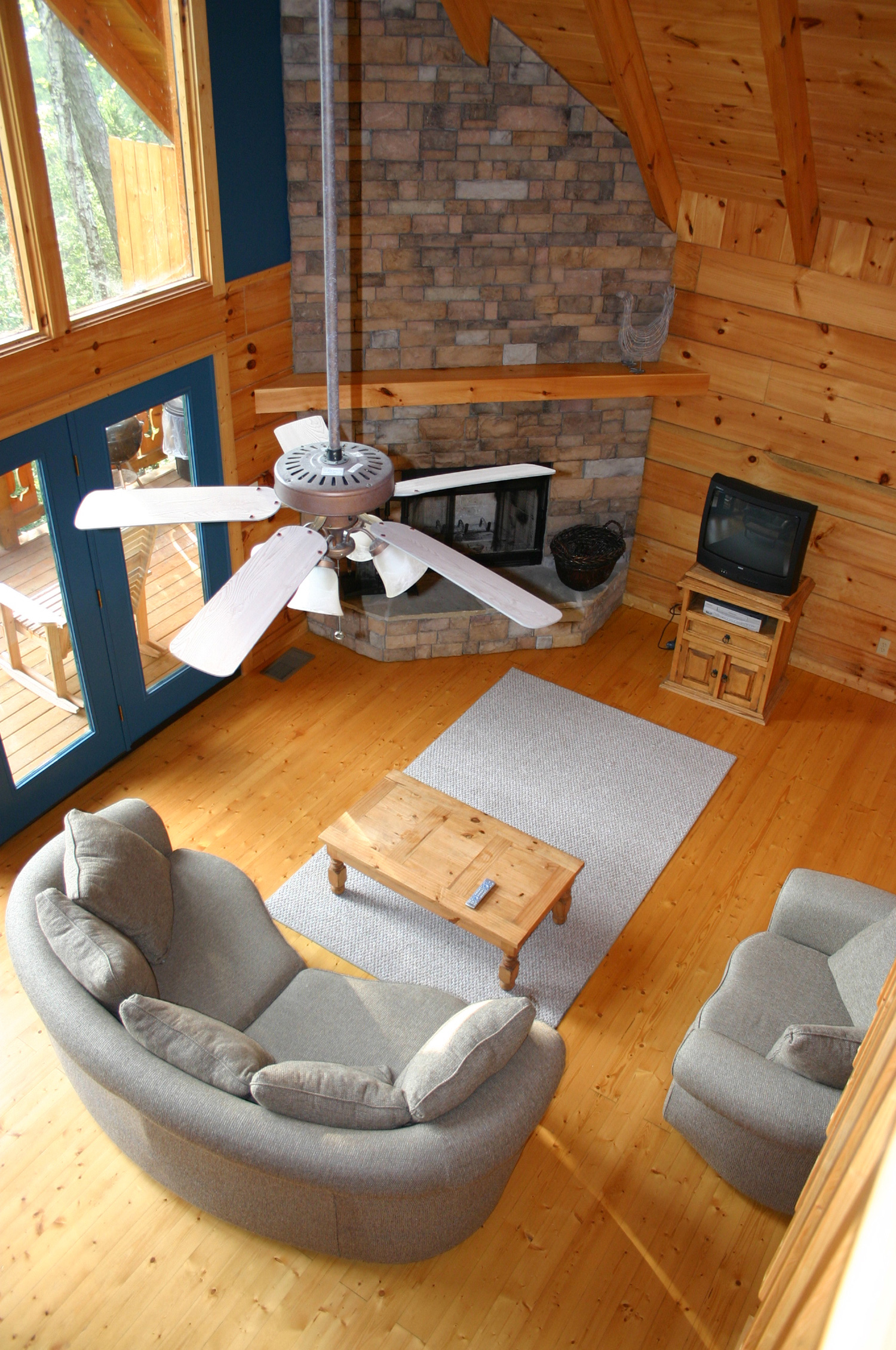 Interior living area of a warm, cozy, cabin in the mountains.