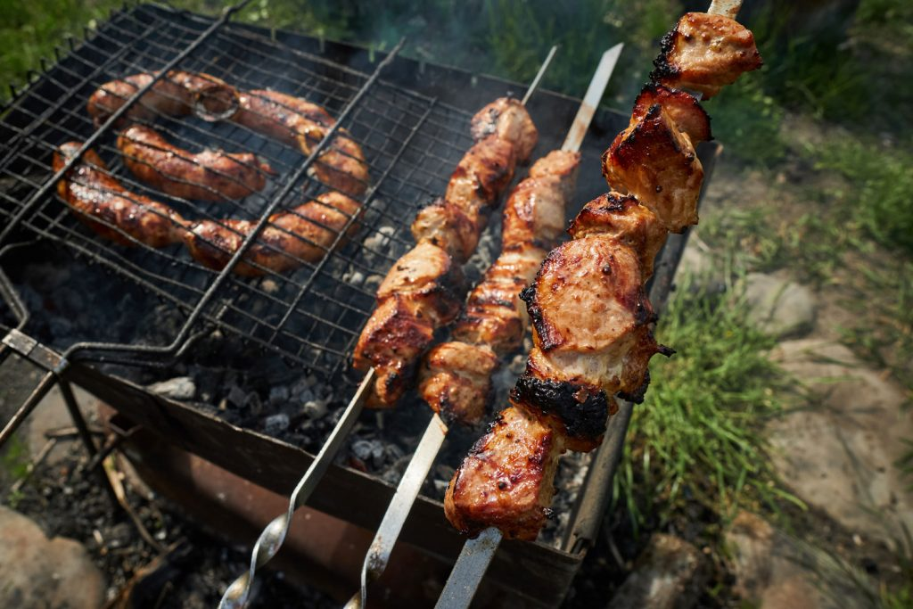 Making barbeque on the portable griller in the outdoors