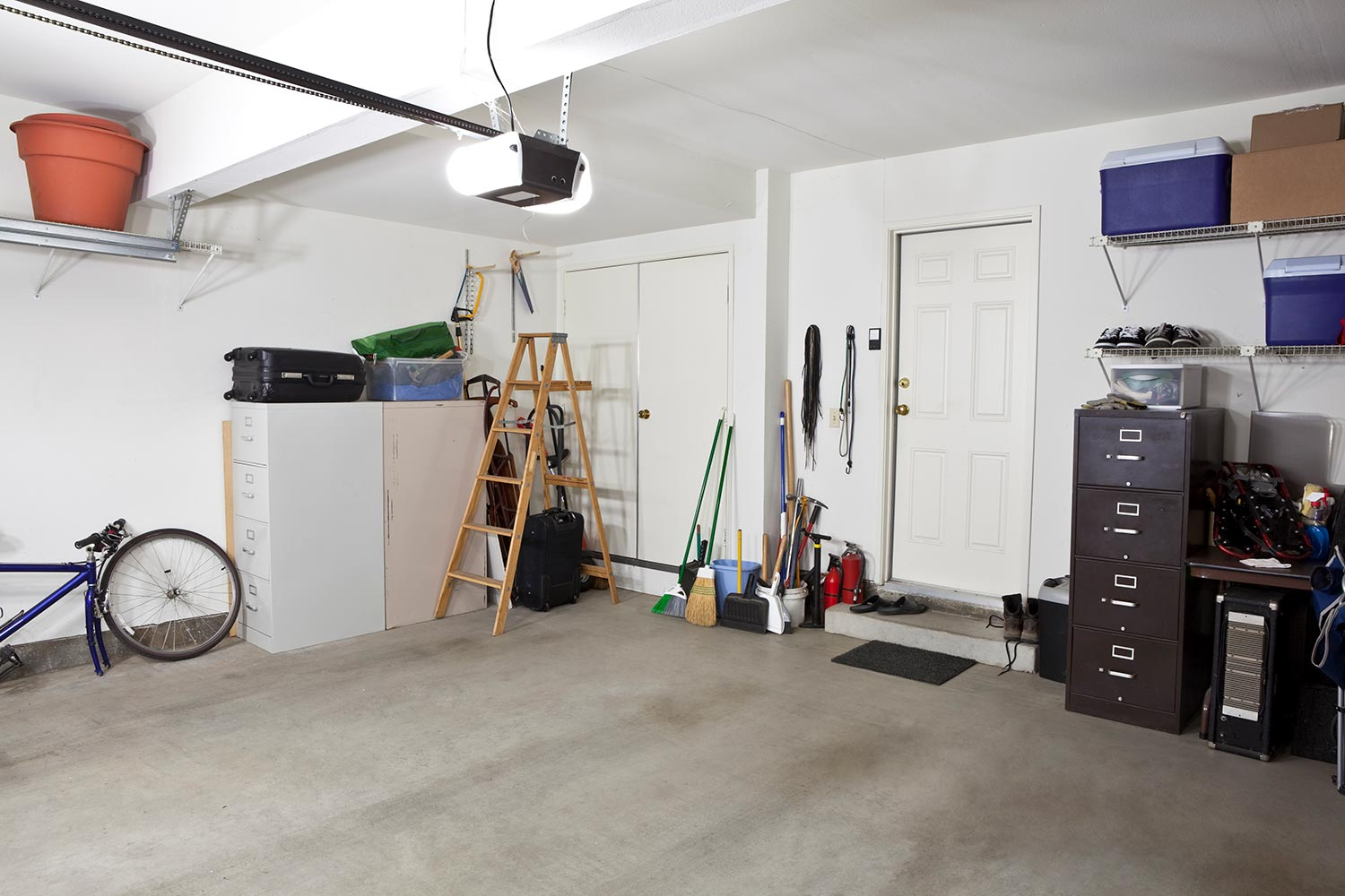 Photo of clean garage with ladder and other tools