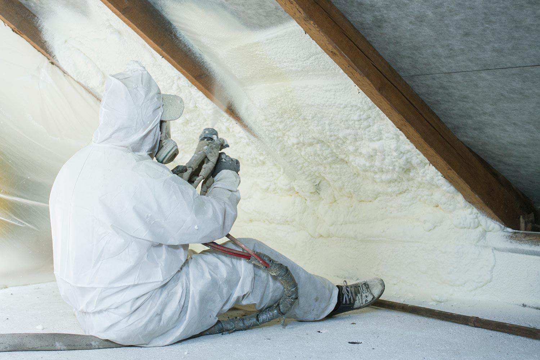 Man spraying polyurethane foam for roof